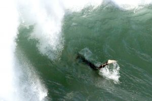 Surfing action Sawtell Southside June 2016 monster swells hit after huge storms.These guys getting pounded by rogue waves breaking another 50 metres out past the take off zone. 39